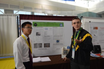 Austin and John at their poster -Photo Huang and Burnett