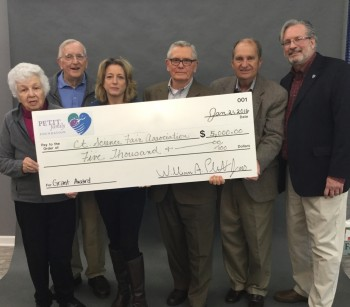 Dr. William Petit Jr. with family members presented the grant check to Bob Wisner and Doug King on January 21